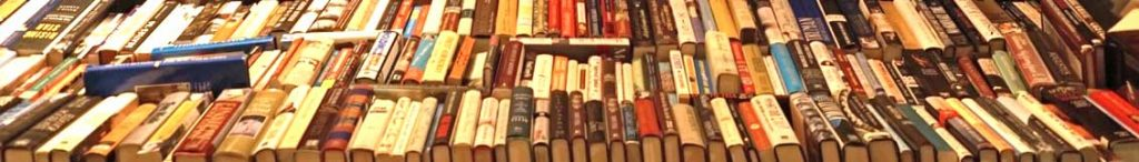 A table of books spine end up